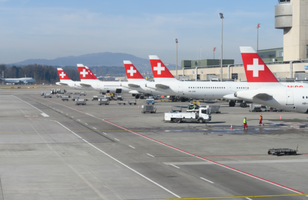 zurich airport with a line of swiss airline aircraft parking at the gate